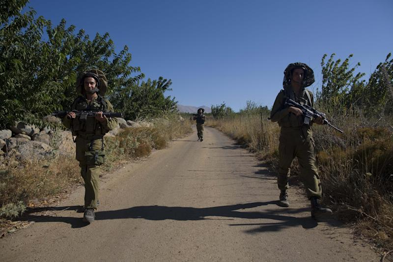 In this photo taken Tuesday, July 24, 2012, Israeli soldiers patrols near the border between Israeli annexed Golan Heights and Syria. (AP Photo / Tsafrir Abayov)