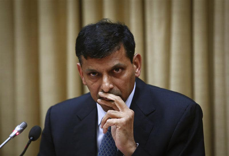 Rajan, newly appointed governor of RBI, listens to a question during a news conference at the bank's headquarters in Mumbai