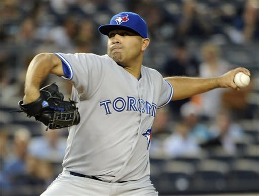 Toronto Blue Jays starting pitcher Ricky Romero throws against the New York Yankees in the second inning of a baseball game on Tuesday, Aug., 28, 2012, in New York. (AP Photo/Kathy Kmonicek)