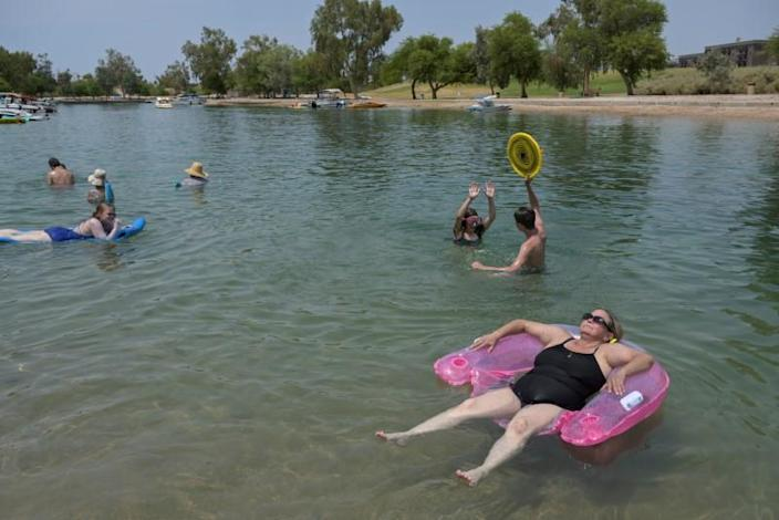 FILE PHOTO: People cool off in the water during a heat wave in Lake Havasu