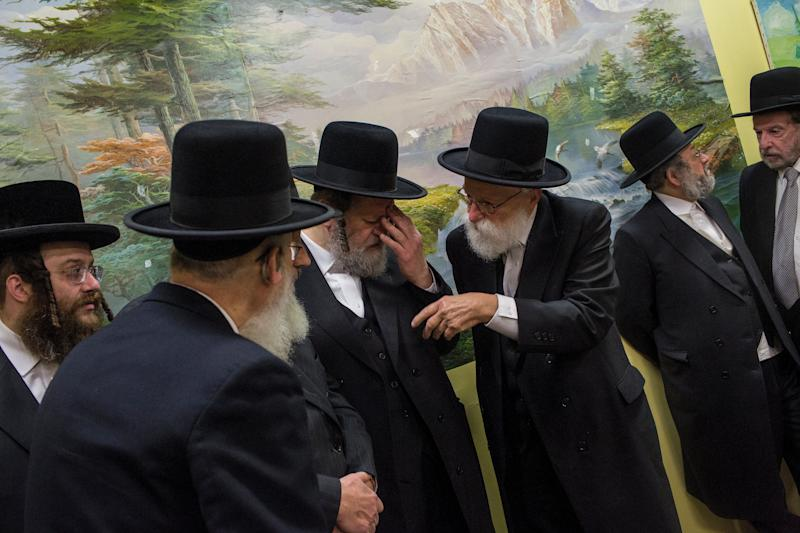 Satmar Orthodox community leaders attend a news conference Thursday with New York City Mayor Bill de Blasio to denounce the attack in Jersey City, New Jersey. (Photo: Andrew Lichtenstein via Getty Images)