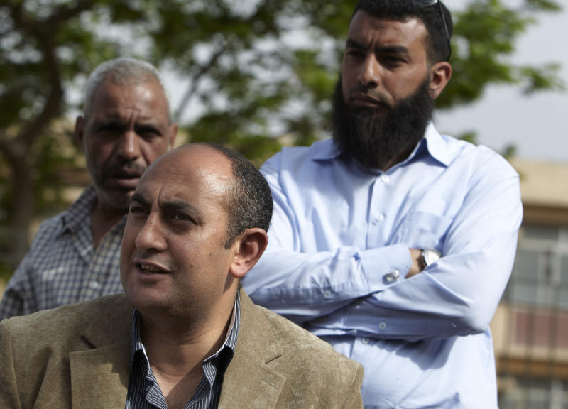 """FILE - In this Monday, April 30, 2012 photo, Egyptian presidential candidate Khaled Ali talks to protesters at a Salafi sit-in on the road leading to the ministry of Defense in Cairo, Egypt. Ali says he will not take part in upcoming presidential elections, calling them a """"farce."""" (AP Photo/Fredrik Persson, File)"""