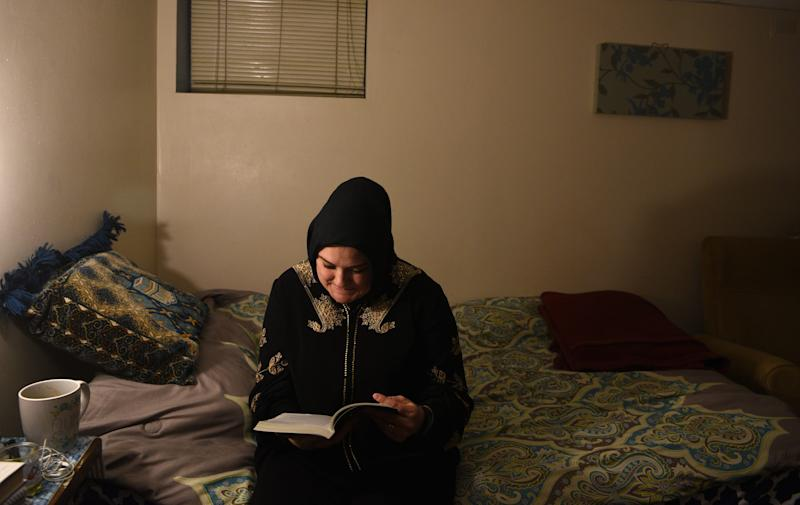 "Khadijah Noor Tanju reads from ""El Corán,"" a Spanish translation of the Quran, after saying Maghrib, evening prayers, at her Hackensack home on November 22, 2019. Raised Catholic, Tanju, a Latina, converted to Islam in June 2015."