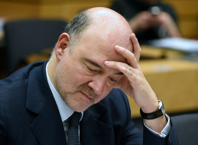 European Union Economic and Financial Affairs, Taxation and Customs Commissioner Pierre Moscovici looks on during an Eurogroup meeting at the headquarters in Brussels, on March 7, 2016 to defuse a bitter rift between top EU and IMF officials over how strictly to hold Greece to the ambitious reform commitments made as part of its bailout.The eurozone 19 ministers are meeting in Brussels just as EU leaders and Turkey hold talks next door to discuss the refugee crisis, in which Greece is also a sensitive focal point