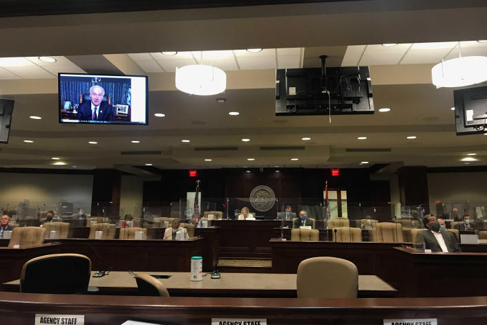 Arkansas Gov. Asa Hutchinson speaks remotely to legislators on Tuesday, Nov. 10, 2020 in Little Rock, Ark., about his proposed budget for the next fiscal year. Hutchinson is proposing $50 million in tax cuts in his budget plan. State lawmakers across the country will be convening in 2021 with the continuing COVID-19 pandemic rippling through much of their work — and even affecting the way they work. After 10 months of emergency orders and restrictions from governors and local executive officials, some state lawmakers are eager to reassert their power over statewide decisions shaping the way people shop, work, worship and attend school (AP Photo/Andrew Demillo)
