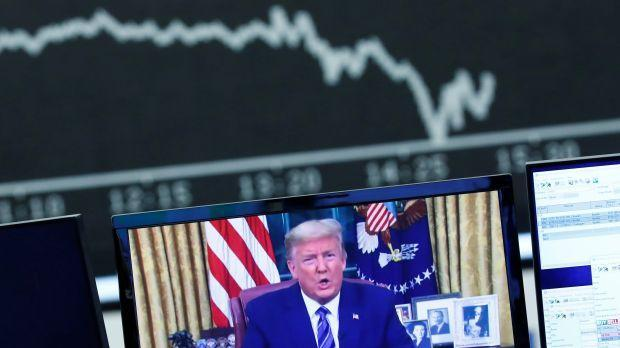 A television broadcast showing U.S. President Donald Trump is pictured during a trading session at Frankfurt's stock exchange in Frankfurt, Germany, March 12, 2020.