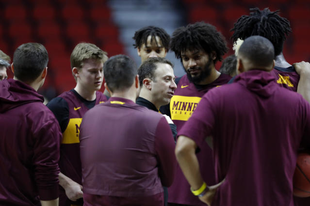 Minnesota head coach Richard Pitino, center, talks to his team during practice at the NCAA men's college basketball tournament, Wednesday, March 20, 2019, in Des Moines, Iowa. Minnesota plays Louisville on Thursday. (AP Photo/Charlie Neibergall)
