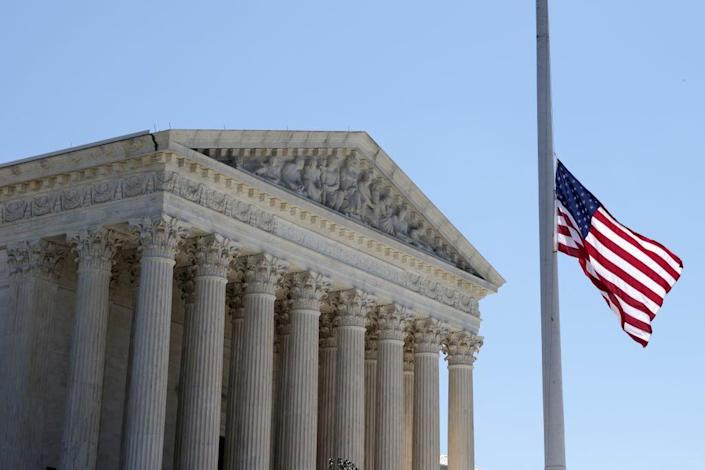 The flag outside the US Supreme Court has flown at half staff since the death on Thursday of Justice Ruth Bader Ginsburg. (Getty Images)