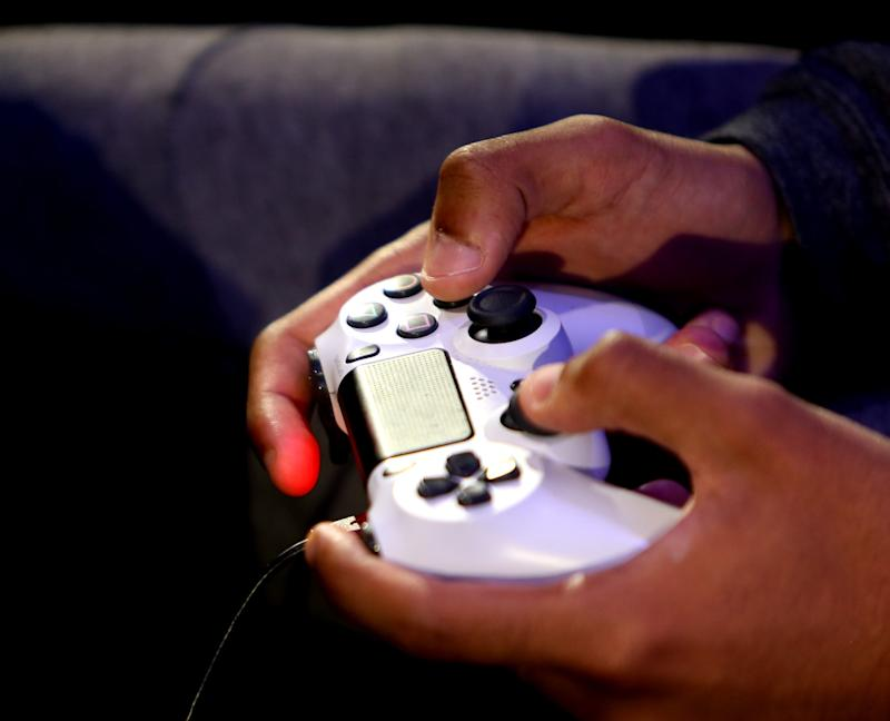 Save $18 on a full year of PlayStation Plus. (Photo: Getty Images)
