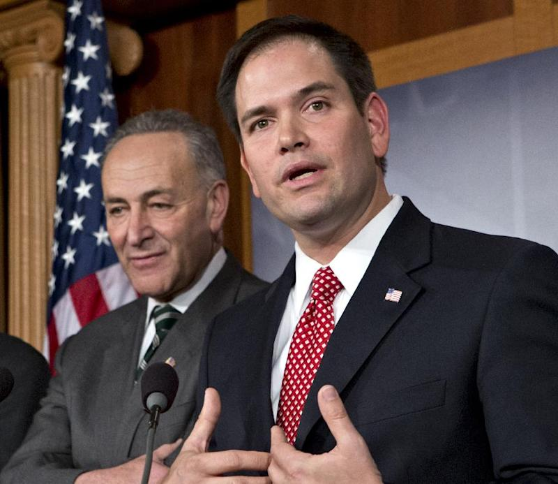 FILE - In this Jan. 28, 2013 file photo, Sen. Marco Rubio, R-Fla., right, accompanied by Sen. Charles Schumer, D-N.Y., gestures as he speaks during a bipartisan group of leading senators to announce that they have reached agreement on the principles of sweeping legislation to rewrite the nation's immigration laws, on Capitol Hill in Washington. Rubio says a new immigration bill he helped write needs stronger border security provisions or it will fail in the House and may even have trouble getting through the Senate. Rubio, who is the chief emissary to conservatives on the contentious legislation, said he's been hearing concerns in recent days that more work is needed to boost the bill's language on the border and he said he's committed to trying to make those changes.  (AP Photo/J. Scott Applewhite, File)