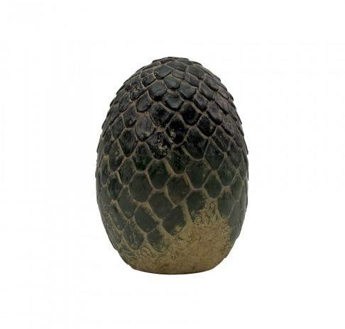 """""""A resin-carved obelisk, <a href=""""http://store.hbo.com/game-of-thrones-dragon-egg-paperweight/detail.php?p=361642&v=hbo_shows_game-of-thrones_jewelry-and-accessories"""" target=""""_blank"""">the paperweight </a>has aged details giving it an appearance of something you'd find on an anthropologist's desk."""""""