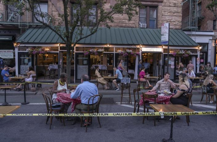 "<span class=""caption"">Harvest Kitchen restaurant, on Manhattan's Upper West Side, making use of New York City's new policy of opening streets to walking, biking and dining.</span> <span class=""attribution""><a class=""link rapid-noclick-resp"" href=""https://www.gettyimages.com/detail/news-photo/harvest-kitchen-restaurant-has-extended-its-outdoor-area-by-news-photo/1222125975?adppopup=true"" rel=""nofollow noopener"" target=""_blank"" data-ylk=""slk:Ron Adar/SOPA Images/LightRocket via Getty Images"">Ron Adar/SOPA Images/LightRocket via Getty Images</a></span>"