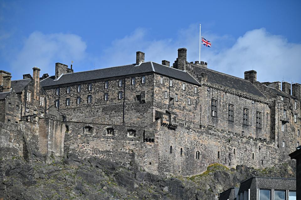 EDINBURGH, SCOTLAND - APRIL 09:  The Union flag flies at half mast to mark the death of the Duke Of Edinburgh at Edinburgh Castle on April 09, 2021 in Edinburgh, United Kingdom. The Queen has announced the death of her beloved husband, His Royal Highness Prince Philip, Duke of Edinburgh. HRH passed away peacefully this morning at Windsor Castle. (Photo by Jeff J Mitchell/Getty Images)