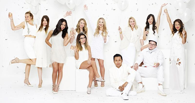The Revolve group management team dressed in white and most of them holding balloons