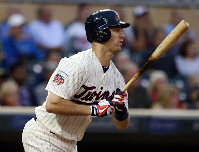 Minnesota Twins' Joe Mauer hits a one-run single off Chicago White Sox pitcher John Danks in the first inning of a baseball game, Wednesday, Sept. 3, 2014, in Minneapolis. (AP Photo/Jim Mone)