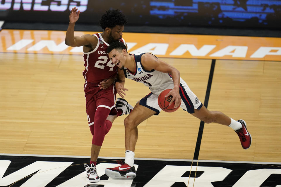 Gonzaga guard Jalen Suggs (1) is fouled by Oklahoma guard Elijah Harkless (24) in the second half of a second-round game in the NCAA men's college basketball tournament at Hinkle Fieldhouse in Indianapolis, Monday, March 22, 2021. (AP Photo/Michael Conroy)