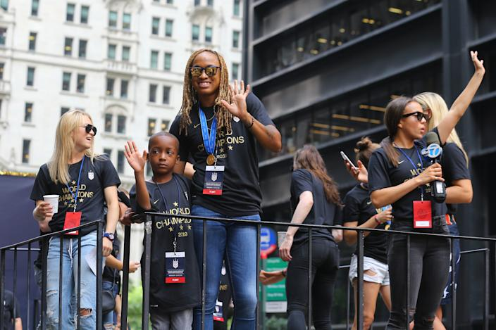 Jessica McDonald and members of the U.S. women's soccer team ride upon a float while being honored with a ticker tape parade along the Canyon of Heroes in New York, Wednesday, July 10, 2019. The U.S. national team beat the Netherlands 2-0 to capture a record fourth Women's World Cup title. (Photo: Gordon Donovan/Yahoo News)