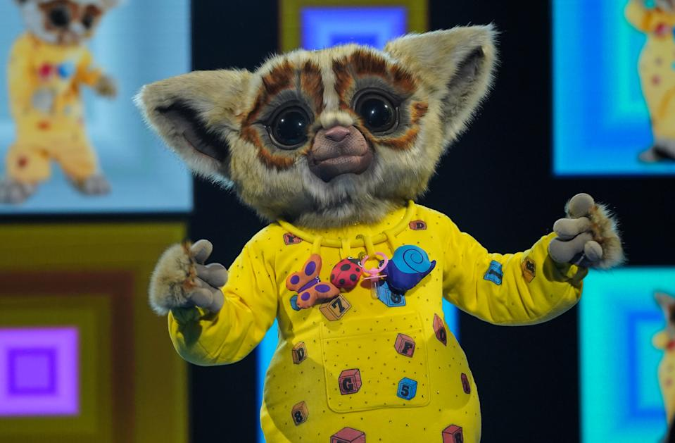 This image and the information contained herein is strictly embargoed until 00.01 Friday 15th January 2021  From Bandicoot TV  The Masked Singer: SR2: Ep4 on ITV  Pictured: Bushbaby.  This photograph is (C) Bandicoot TV and can only be reproduced for editorial purposes directly in connection with the programme or event mentioned above, or ITV plc. Once made available by ITV plc Picture Desk, this photograph can be reproduced once only up until the transmission [TX] date and no reproduction fee will be charged. Any subsequent usage may incur a fee. This photograph must not be manipulated [excluding basic cropping] in a manner which alters the visual appearance of the person photographed deemed detrimental or inappropriate by ITV plc Picture Desk.  This photograph must not be syndicated to any other company, publication or website, or permanently archived, without the express written permission of ITV Picture Desk. Full Terms and conditions are available on the website www.itv.com/presscentre/itvpictures/terms  For further information please contact: james.hilder@itv.com / 0207 157 3052