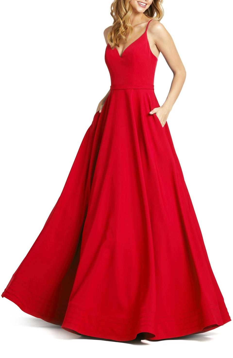 """<h2>Mac Duggal Crepe Gown In Red</h2><br>Nothing makes a statement like a fire-engine red, floor-length gown. <br><br><em>Shop Mac Duggal at <strong><a href=""""https://www.nordstrom.com/brands/mac-duggal--11958"""" rel=""""nofollow noopener"""" target=""""_blank"""" data-ylk=""""slk:Nordstrom"""" class=""""link rapid-noclick-resp"""">Nordstrom</a></strong></em><br><br><strong>Mac Duggal</strong> V-Neck Crepe Ballgown, $, available at <a href=""""https://go.skimresources.com/?id=30283X879131&url=https%3A%2F%2Fwww.nordstrom.com%2Fs%2Fmac-duggal-v-neck-crepe-ballgown%2F5370911%3F%26color%3Dred"""" rel=""""nofollow noopener"""" target=""""_blank"""" data-ylk=""""slk:Nordstrom"""" class=""""link rapid-noclick-resp"""">Nordstrom</a>"""