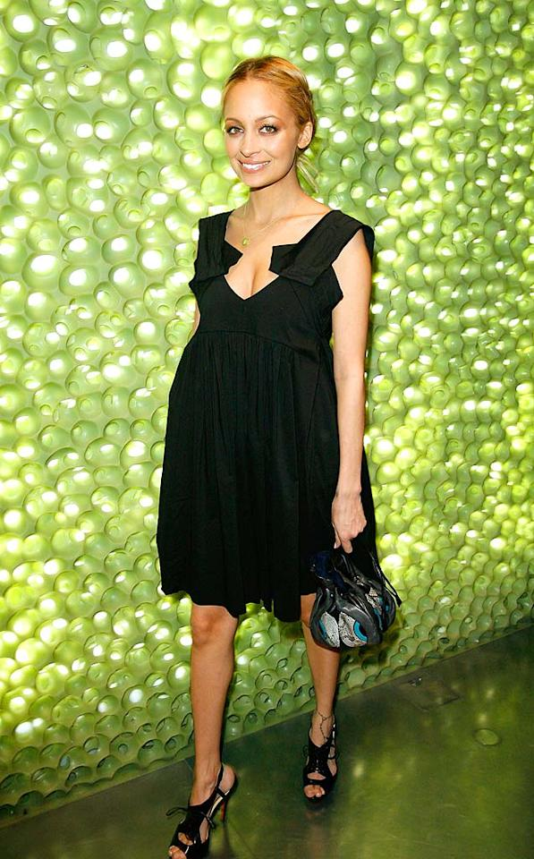 "Is new mom Nicole Richie pregnant again? She's not, but this Miu Miu frock sure makes it look like she is! Donato Sardella/<a href=""http://www.wireimage.com"" target=""new"">WireImage.com</a> - March 19, 2008"