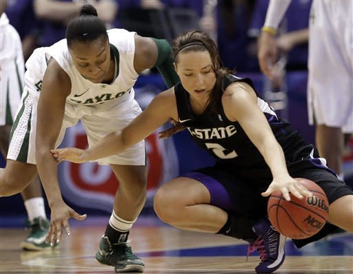 Baylor's Odyssey Sims, left, causes Kansas State's Brittany Chambers (2) to lose control of the ball during the second half of an NCAA college basketball game in the Big 12 Conference tournament on Saturday March 9, 2013, in Dallas. Baylor won 80-47. (AP Photo/LM Otero)