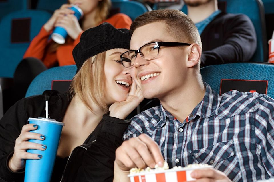 people talking in a movie theater