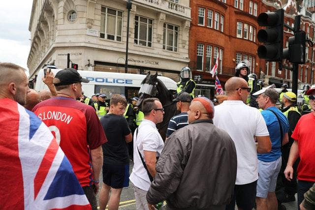Tommy Robinson supporters are watched by police