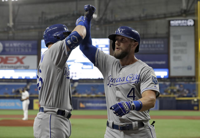 Kansas City Royals' Alex Gordon (4) celebrates his home run off Tampa Bay Rays pitcher Yonny Chirinos with Ryan O'Hearn during the first inning of a baseball game Monday, April 22, 2019, in St. Petersburg, Fla. (AP Photo/Chris O'Meara)