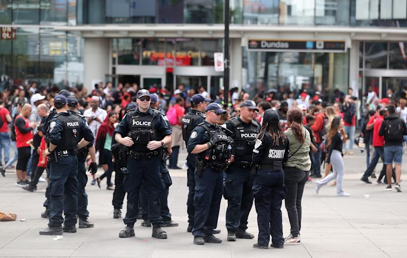 TORONTO, ON- JUNE 17 - Police stand in Yonge Dundas Square as they investigate a shooting or stabbing as the Toronto Raptors hold their victory parade after beating the Golden State Warriors in the NBA Finals in Toronto. June 17, 2019. (Steve Russell/Toronto Star via Getty Images)