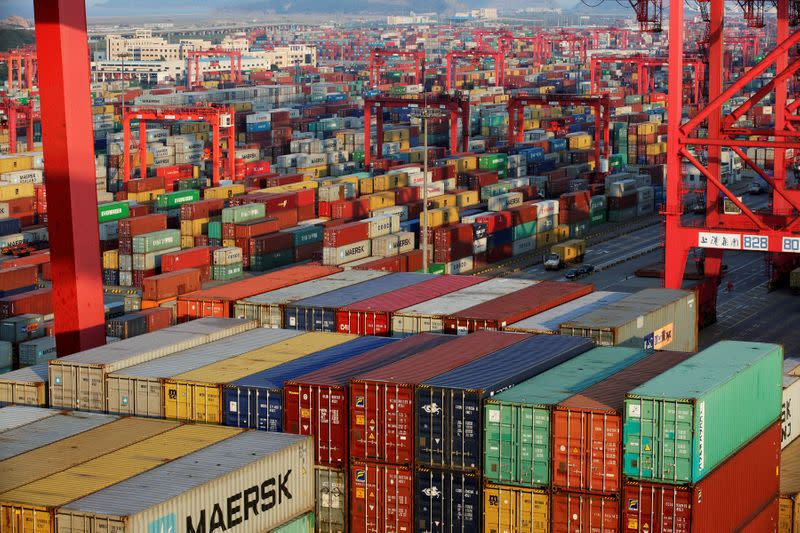 FILE PHOTO: Container boxes are seen at the Yangshan Deep Water Port, part of the Shanghai Free Trade Zone, in Shanghai
