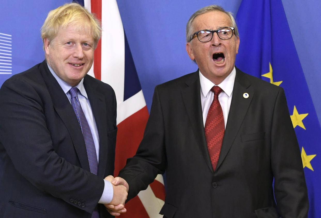 UK prime minister Boris Johnson and European Commission president Jean-Claude Juncker shake hands on the deal in Brussels on Thursday. Photo: Didier Lebrun/©Photo News via Getty
