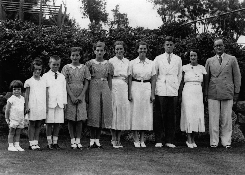 "<p>Jean (second from left) and her siblings, Edward ""Ted,"" Robert, Patricia, Eunice, Kathleen, Rosemary and John pose with their parents shortly after their father, millionaire Joseph Patrick Kennedy was appointed ambassador to Great Britain.</p>"