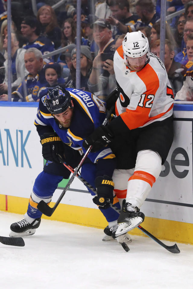 St. Louis Blues center Ryan O'Reilly (90) fights Philadelphia Flyers forward Michael Raffl (12) of Austria during the second period of an NHL hockey game Wednesday, Jan. 15, 2020 in St. Louis. (AP Photo/Dilip Vishwanat)