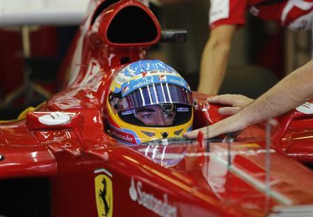 Ferrari Formula One driver Fernando Alonso of Spain sits in his car during the third practice session of the Abu Dhabi F1 Grand Prix at the Yas Marina circuit on Yas Island, November 2, 2013. Ferrari Formula One driver Fernando Alonso of Spain sits in his car during the third practice session of the Abu Dhabi F1 Grand Prix at the Yas Marina circuit on Yas Island, November 2, 2013.
