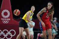 United States's Brittney Griner (15) runs down a loose ball ahead of Australia's Jenna O'Hea, left, during a women's basketball quarterfinal round game at the 2020 Summer Olympics, Wednesday, Aug. 4, 2021, in Saitama, Japan. (AP Photo/Charlie Neibergall)