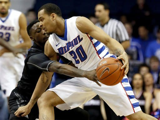 Cincinnati guard Cashmere Wright, left, defends against DePaul guard Brandon Young during the first half of an NCAA college basketball game, Tuesday, Jan. 15, 2013, in Rosemont, Ill. (AP Photo/Charles Rex Arbogast)