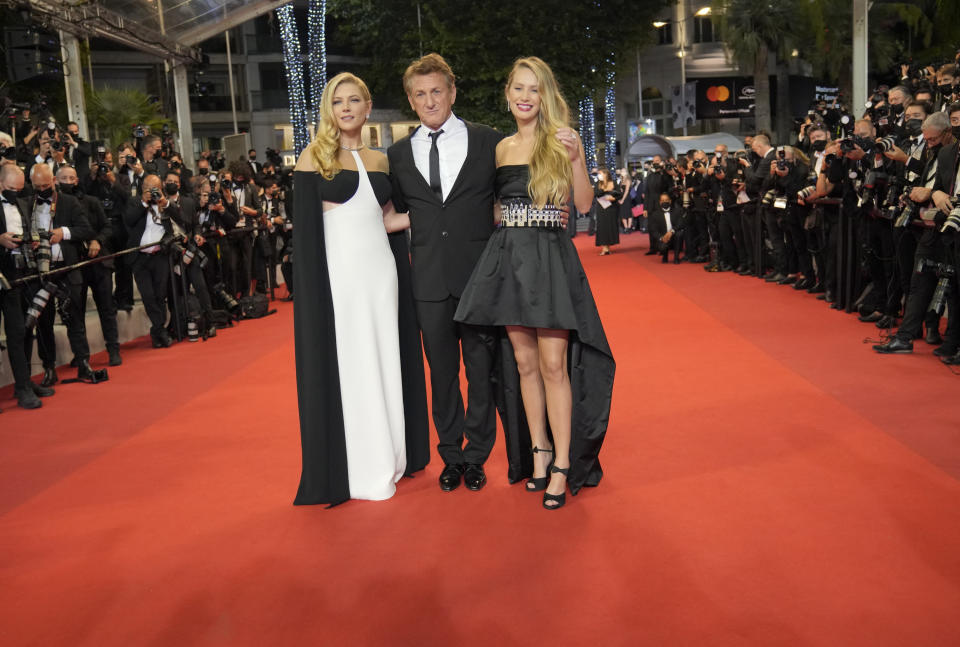 Katheryn Winnick, from left, Sean Penn, and Dylan Penn pose for photographers upon arrival at the premiere of the film 'Flag Day' at the 74th international film festival, Cannes, southern France, Saturday, July 10, 2021. (AP Photo/Vadim Ghirda)