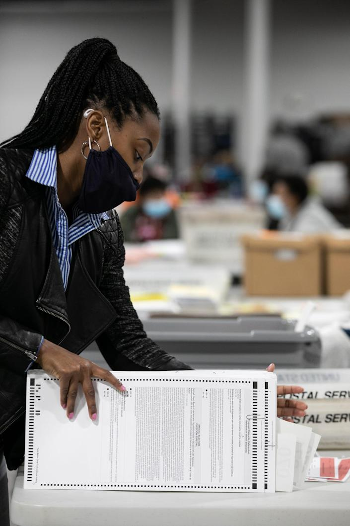 A Gwinnett County election worker processes absentee and provisional ballots on November 6, 2020 in Georgia.