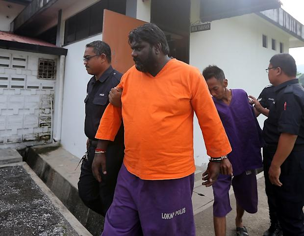 N. Shasi Kumar (centre), who claimed trial, was accused of committing the offence at about 5.45am that caused the death of Chan Kwai Fah, 43. — Picture by Farhan Najib