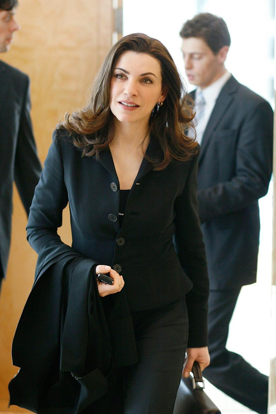 "Julianna Margulies, seen in a picture from her critically acclaimed drama ""The Good Wife,"" almost didn't become a regular on ""ER,"" because her character originally died in the series pilot."