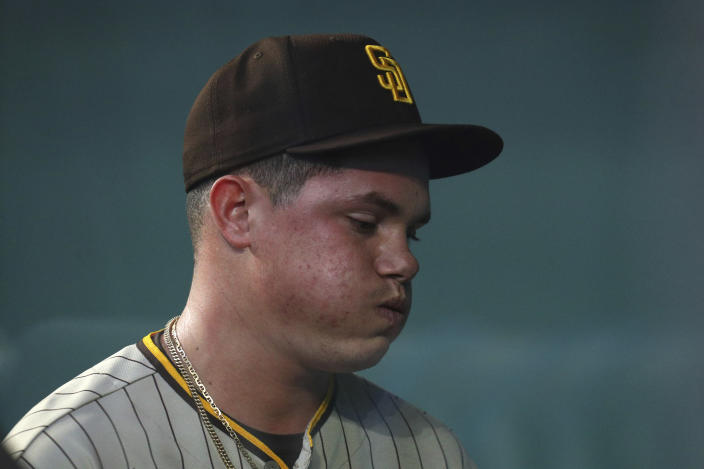San Diego Padres starting pitcher Adrian Morejon reacts after leaving the baseball game against the Texas Rangers in the first inning on Sunday, April 11, 2021, in Arlington, Texas. (AP Photo/Richard W. Rodriguez)