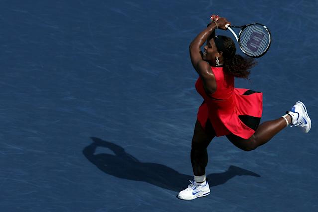 NEW YORK, NY - SEPTEMBER 08: Serena Williams of the United States returns a shot against Anastasia Pavlyuchenkova of Russia during Day Eleven of the 2011 US Open at the USTA Billie Jean King National Tennis Center on September 8, 2011 in the Flushing neighborhood of the Queens borough of New York City. (Photo by Nick Laham/Getty Images)