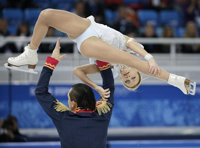 Tatiana Volosozhar and Maxim Trankov of Russia compete in the team pairs short program figure skating competition at the Iceberg Skating Palace during the 2014 Winter Olympics, Thursday, Feb. 6, 2014, in Sochi, Russia. (AP Photo/Bernat Armangue)