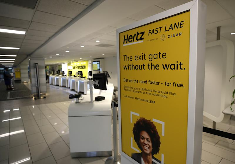 SAN FRANCISCO, CALIFORNIA - APRIL 30: A sign is posted in the entrance to the Hertz Rent-A-Car desk at San Francisco International Airport on April 30, 2020 in San Francisco, California. According to a report in the Wall Street Journal, car rental company Hertz is preparing to file for bankruptcy as the travel industry has come to a standstill due to the coronavirus (COVID-19) pandemic. (Photo by Justin Sullivan/Getty Images)