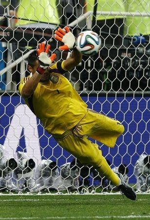 Argentina's goalkeeper Sergio Romero saves the match deciding penalty in their 2014 World Cup semi-finals against Netherlands at the Corinthians arena in Sao Paulo July 9, 2014. REUTERS/Darren Staples