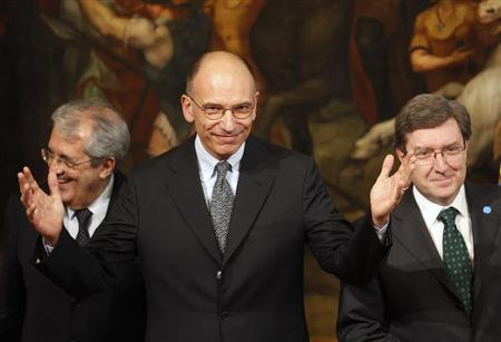 "Italy's Prime Minister Letta gestures next to Economy Minister Saccomanni and Labour Minister Giovannini during a meeting for ""Jobs for Youth - Building Opportunities, Opening Paths"", at Palazzo Chigi in Rome"