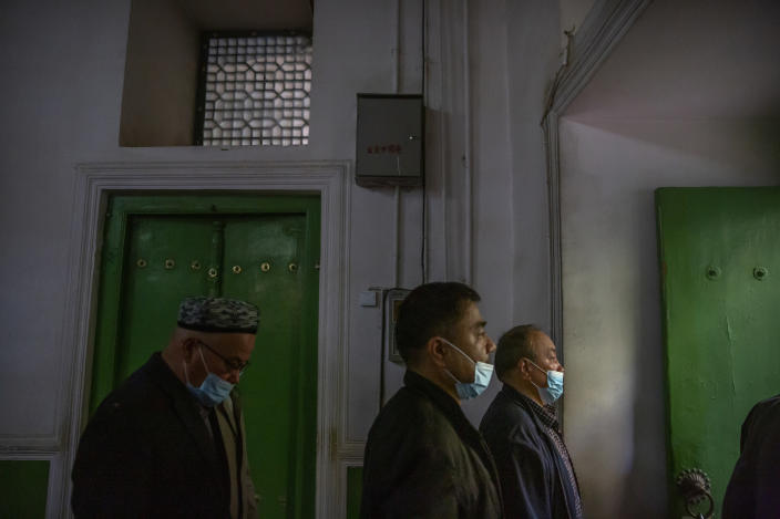 Uyghurs and other members of the faithful leave after prayer services at the Id Kah Mosque in Kashgar in western China's Xinjiang Uyghur Autonomous Region, as seen during a government organized visit for foreign journalists on April 19, 2021. Under the weight of official policies, the future of Islam appears precarious in Xinjiang, a remote region facing Central Asia in China's northwest corner. Outside observers say scores of mosques have been demolished, which Beijing denies, and locals say the number of worshippers is on the decline. (AP Photo/Mark Schiefelbein)