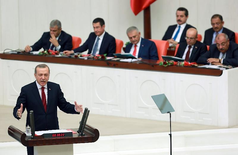 Turkish President Recep Tayyip Erdogan addresses MP at the National Assembly in Ankara, on October 1, 2016