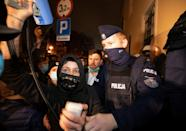 Demonstrators scuffle with police officers during a protest against imposing further restrictions on abortion law, near the Archbishop's Palace in Poznan, Poland October 23, 2020. Piotr Skornicki/Agencja Gazeta/via REUTERS ATTENTION EDITORS - THIS IMAGE WAS PROVIDED BY A THIRD PARTY. POLAND OUT. NO COMMERCIAL OR EDITORIAL SALES IN POLAND.