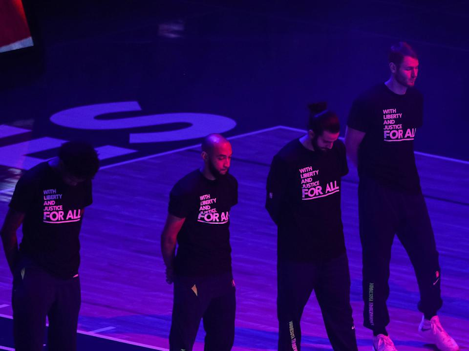 Minnesota Timberwolves players where T-shirts promoting social justice (Getty Images)